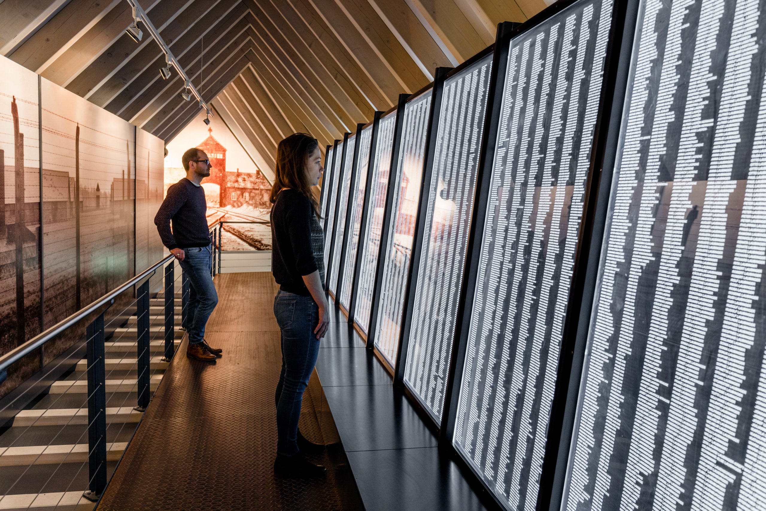 The last part of the permanent exhibition in Heidelberg. The tour ends on a walkway with a wall displaying the names of the more than 21.000 Sinti and Roma who were deported to Auschwitz-Birkenau, where almost all of them were murdered